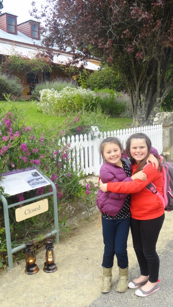 Miss 8 (right) and her cousin were too scared to enter the parsonage.