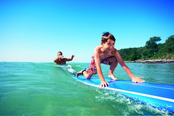 Surf lessons are one of the activities your children can enjoy on the Sunshine Coast.