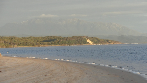 Looking back from Macquarie Heads towards Strahan, with Mt Lyell in the background.