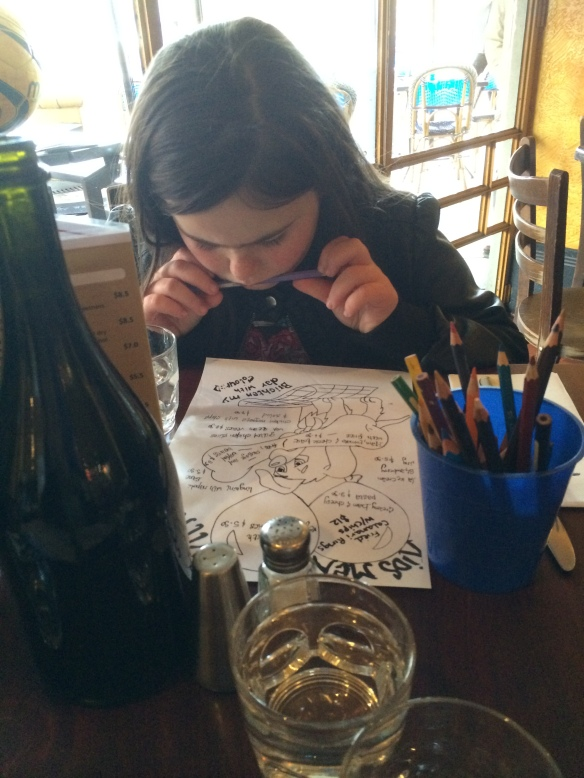 Studying the kids menu at Zenith Bar & Restaurant in St Kilda